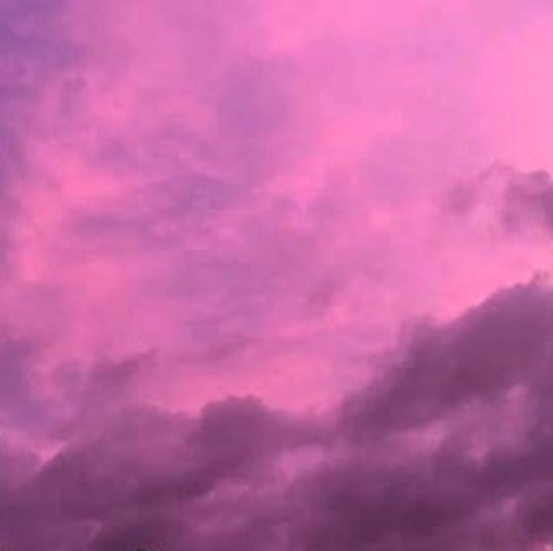 Actual purple clouds in a pink and purple sky near Houston Texas